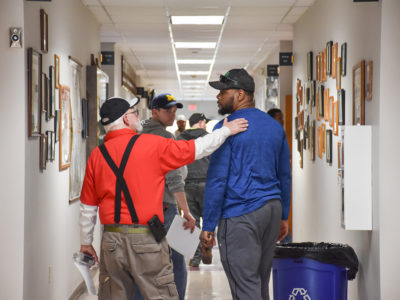 electricians in hallway